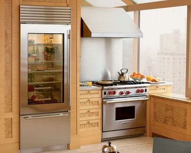 a kitchen with a sub zero refrigerator unit